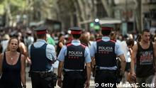 BARCELONA, SPAIN - AUGUST 19: Police officers patrol Las Ramblas near the scene of Thursday's terrorist attack, on August 19, 2017 in Barcelona, Spain. A nationwide manhunt continues for Younes Abouyaaqoub, now named by Spanish media as the suspected driver in an attack that left thirteen people dead and dozens injured when a van was driven at crowds in the popular Las Ramblas area of Barcelona on Thursday. (Photo by Carl Court/Getty Images)