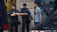 Police officers stand guard on Las Ramblas boulevard in Barcelona on August 19, 2017, two days after a van ploughed into the crowd, killing 13 persons and injuring over 100. Drivers have ploughed on August 17, 2017 into pedestrians in two quick-succession, separate attacks in Barcelona and another popular Spanish seaside city, leaving 14 people dead and injuring more than 100 others. / AFP PHOTO / LLUIS GENE (Photo credit should read LLUIS GENE/AFP/Getty Images)