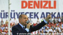 Turkey's President Recep Tayyip Erdogan, gestures as he talks to supporters in Denizli