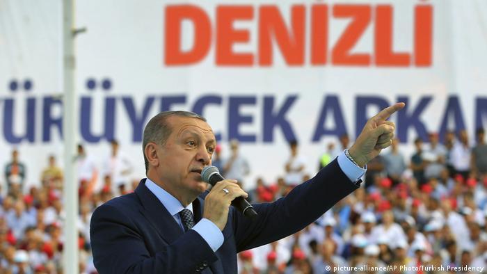 Turkey's President Recep Tayyip Erdogan, gestures as he talks to supporters in Denizli