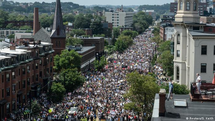 A large crowd of people march towards the Boston Commons to protest the Boston Free Speech Rally in Boston, MA (Reuters/S. Keith)