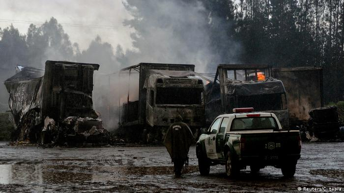 Some of the trucks burned in a parking lot near Temuco, southern Chile
