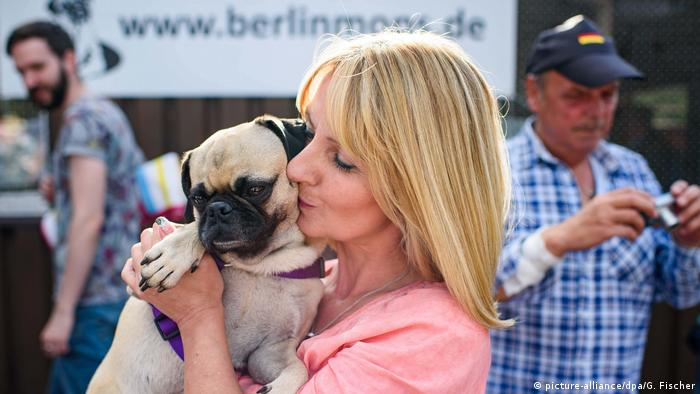 Angela Kaiser and her winning dog, Emma, celebrate her win at the 8th International Pug Meeting