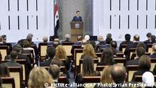 In this photo released by the official Facebook page of the Syrian Presidency, Syrian President Bashar Assad speaks to dozens of Syrian diplomats, in Damascus, Syria, Sunday, Aug. 20, 2017. In defiant comments Sunday, Assad blasted the West, rejecting any security cooperation or reopening of embassies in Damascus before those countries cut relations with opposition groups. In the speech, Assad praised Russia, Iran, China and Lebanon's Hezbollah for supporting his government. (Syrian Presidency Facebook page via AP) |