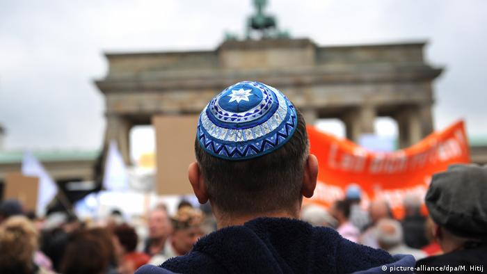 A person wearing a kippah, a Jewish head covering, attends an anti-Semitism rally in Berlin
