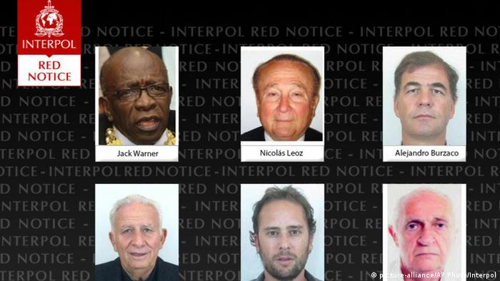 A screenshot showing the faces of six men wanted by Interpol