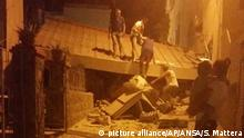 People worked to remove debris after the quake hit Ischia
