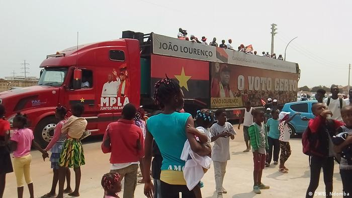 A truck with bills and supporters of the ruling MPLA party