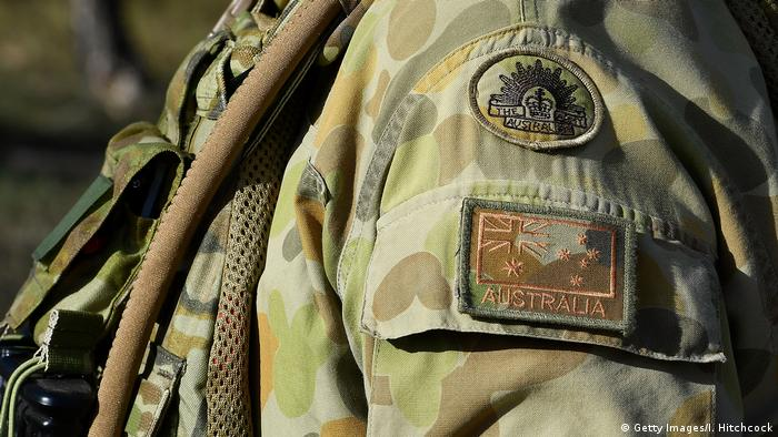 The shoulder insignia of an Australian soldier is seen at the Williamson airfield (Getty Images/I. Hitchcock)