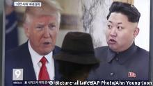 Südkorea TV Bildschirm mit Donald Trump und Kim Jong Un