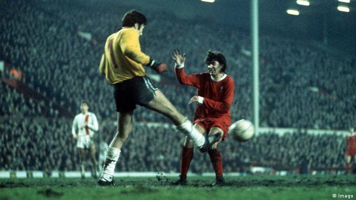 Werner Limsa (Dynamo Berlin goalkeeper) kicks away from the on coming Peter Cormack (Liverpool FC) Liverpool FC v Dynamo Berlin. UEFA Cup at Anfield. 2nd leg; 13/12/1972.