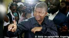 23.08.2017+++ MPLA (The People's Movement for the Liberation of Angola) presidential candidate Joao Lourenco shows his inked finger after voting in Luanda, on August 23, 2017 during the general elections. Angolans cast their ballots on August 23 in an election marking the end of President Jose Eduardo Dos Santos's 38-year reign, with his MPLA party set to retain power despite an economic crisis. / AFP PHOTO / AMPE ROGERIO (Photo credit should read AMPE ROGERIO/AFP/Getty Images)
