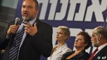 Avigdor Lieberman, head of the ultranationalist Yisrael Beitenu party, delivers a speech at the party's headquarters in Jerusalem, late Tuesday, Feb. 10, 2009. Exit polls put Lieberman's Yisrael Beitenu Party in third place behind Kadima and Likud and ahead of Labor, the party that ruled Israel for decades. That gives Lieberman, who based his campaign on denying citizenship to Israeli Arabs he considers disloyal, a key role in coalition building.(AP Photo/Dan Balilty)