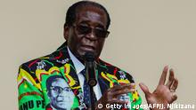 Zimbabwe President Robert Mugabe speaks at the party's annual conference (Getty Images/AFP/J. Njikizana)