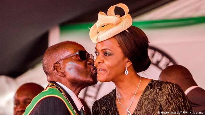 President Robert Mugabe planting a kiss on the cheek of his wife, Grace
