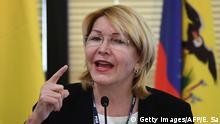 Venezuela's fugitive former top prosecutor Luisa Ortega, one of President Nicolas Maduro's most vocal critics, invited by Brazil's prosecutor general Rodrigo Janot, speaks during a conference with representatives from the Latin American regional trading alliance Mercosur, in Brasilia, on August 23, 2017. Ortega promised to use the international forum in Brazil to intensify corruption allegations against Maduro, who called for her arrest. Days after a dramatic escape from Venezuela, Ortega arrived in Brasilia promising to dish dirt on Maduro, who in turn asked Interpol to put out a red notice warrant for his critic. / AFP PHOTO / EVARISTO SA (Photo credit should read EVARISTO SA/AFP/Getty Images)
