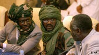 Justice and Equality Movement, JEM, leader Dr. Khalil Ibrahim, center, and his brother Jibril Ibrahim, left, are seen during the Darfur Peace talks, in Doha, Qatar, Wednesday, Feb. 11, 2009. A mediator between a powerful Darfur rebel group and the Sudanese government says the two sides are close to declaring a cease-fire. The U.N. and African Union mediator, Djibril Bassole, says a cease-fire will be announced as soon as Wednesday between the Justice and Equality Movement and the Sudanese government. (AP Photos/Maneesh Bakshi)