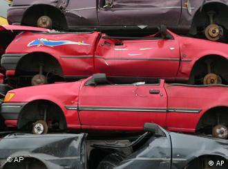 Wrecked cars stacked up in a scrapyard in Hamburg