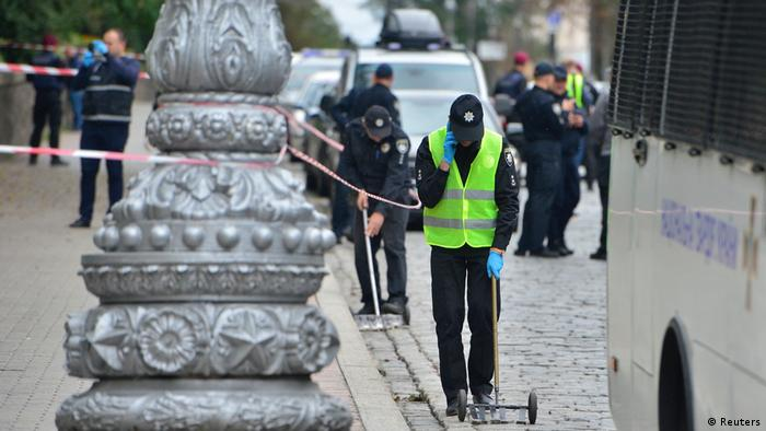 Police in Kyiv investigate the scene of the explosion