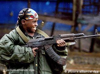 Child holding machine gun