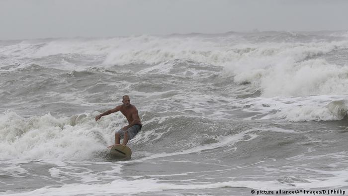 A man surfing in Galveston, Texas before Hurricane Harvey makes landfall