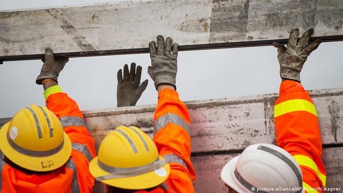 Emergency services install a surge wall near Texas' coastline ahead of Hurricane Harvey's landfall