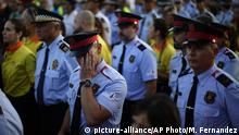 25.08.2017 A Mossos d'Esquadra regional police officer gestures during a rally to commemorate those killed in the recent attacks in Barcelona, in Cambrils, Spain, Friday, Aug. 25, 2017. The Islamic State group has claimed responsibility for the attacks on Aug. 17-18 in Barcelona and Cambrils that left 15 dead and more than 120 injured. Eight suspects are dead and four more under investigation, two of them in jail. (AP Photo/Manu Fernandez) |