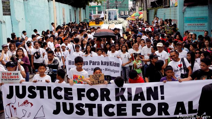 Mourners in the Philippines display a banner