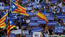 People hold placards and flag as they take part in a march of unity after the attacks last week, in Barcelona, Spain, August 26, 2017. REUTERS/Albert Gea