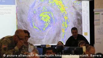 Officials at the State of Texas Emergency Command Center at Department of Public Safety headquarters monitor Hurricane Harvey in Austin, Texas