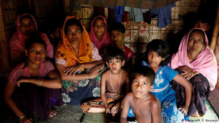A group of Rohingya refugees takes shelter at the Kutuupalang makeshift refugee camp