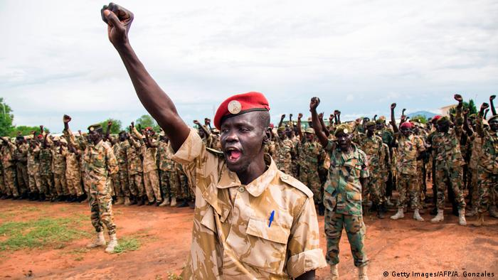 Soldiers from the Sudan People's Liberation Army raise their fists