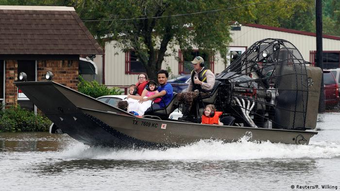 A family is rescued from flood waters from Hurricane Harvey on an air boat in Dickenson, Texas (Reuters/R. Wilking)