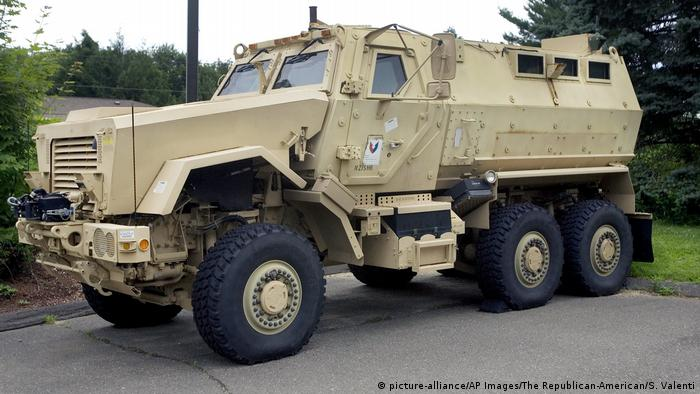 A Mine-Resistant Ambush Protected (MRAP) vehicle sits in front of police headquarters in Watertown, Conn
