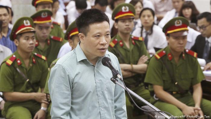 The former chairman of Ocean Bank, Va Van Tham, on trial in Vietnam