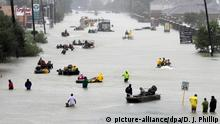 28.08.2017 Rescue boats fill a flooded street at flood victims are evacuated as floodwaters from Tropical Storm Harvey rise Monday, Aug. 28, 2017, in Houston. (AP Photo/David J. Phillip)