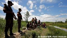 Members of Border Guard Bangladesh (BGB) stands guard to prevent Rohingya people to enter inside Bangladesh border, in Cox's Bazar, Bangladesh, August 27, 2017. REUTERS/Mohammad Ponir Hossain