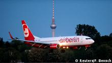 FILE PHOTO: An aircraft operated by German carrier Air Berlin lands in Berlin's Tegel airport, May 3, 2014. REUTERS/Fabrizio Bensch/File Photo