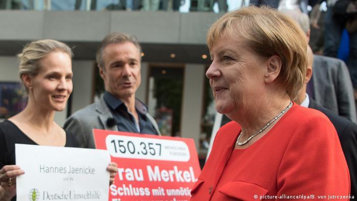Hannes Jaenicke y Angela Merkel.