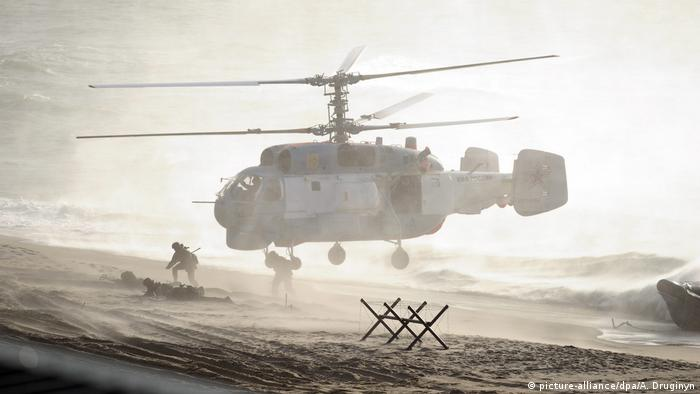 Troops jump out of a helicopter during Russian-Belarusian strategic military exercises Zapad-2013