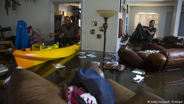 Two men in their flooded home in Houston (Getty Images/E. Schlegel)