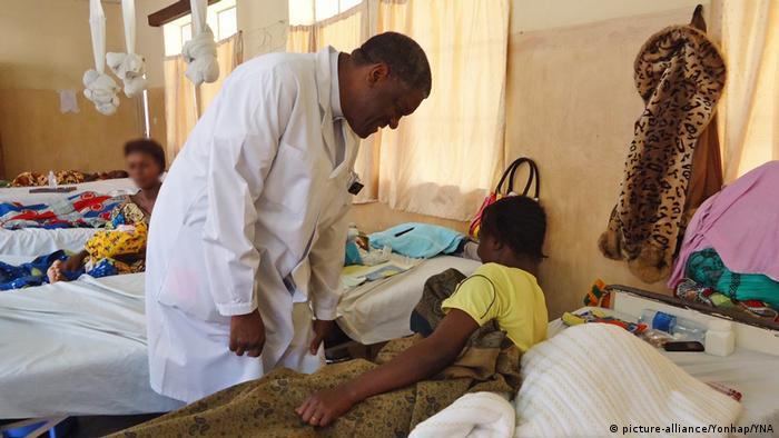 Dr Mukwege checking on a patient
