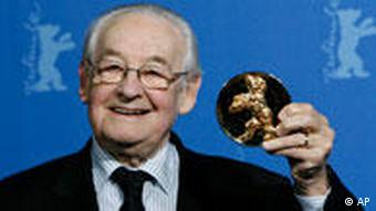 Andrzej Wajda holding up award at film ceremony