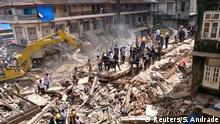 Firefighters and rescue workers search for survivors at the site of a collapsed building in Mumbai, India, August 31, 2017. REUTERS/Shailesh Andrade
