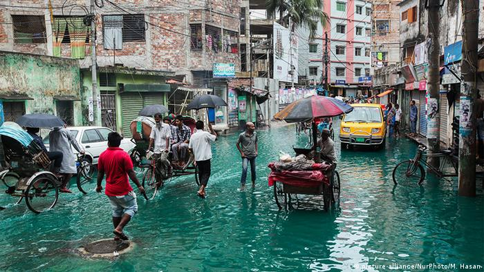 A heavy monsoon rain water and industrial chemicals paralyzed the streets of Old Dhaka in Bangladesh