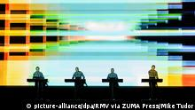 Kraftwerk performing live with a colorful and abstract illuminated backdrop (picture-alliance/dpa/RMV via ZUMA Press/Mike Tudor)