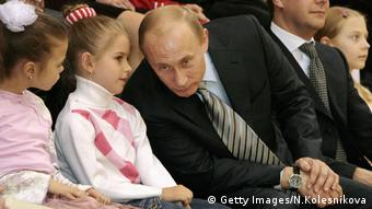 Vladimir Putin with two young girls