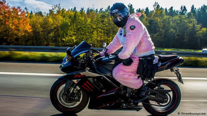 A man in a pink bunny costume on a motorcycle (Streetbunnycrew)