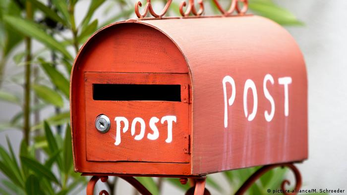A red mailbox with the word Post written on it
