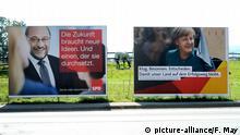 Wahlplakate der Spitzenkandidaten der Sozialdemokraten, Martin Schulz (SPD) links und Bundeskanzlerin Angela Merkel (CDU) rechts - Bundestagswahl 2017, aufgenommen am 29.08.2017 in Teichhütte. Foto: Frank May/picture alliance | Verwendung weltweit